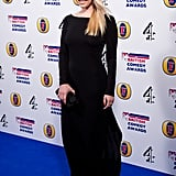 Alice Eve wore a black maxi dress with nude heels.