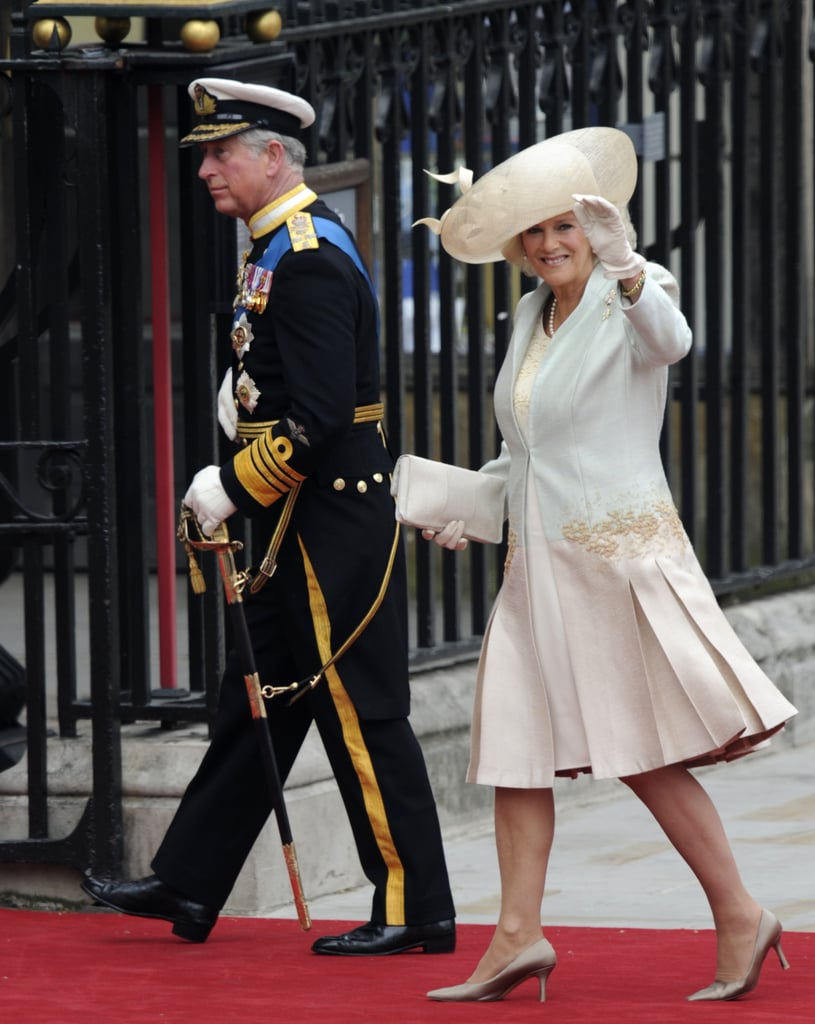 Prince Charles and his wife, Camilla Parker Bowles, made their way from Clarence House to Westminster Abbey this morning. They waved to fans as they traveled down the mall by car. Charles and Camilla followed the arrival of Carole and Michael Middleton, who came to the big event from The Goring Hotel. The father of the groom looked regal in his Royal Navy uniform while Camilla chose an outfit by Anna Valentine.