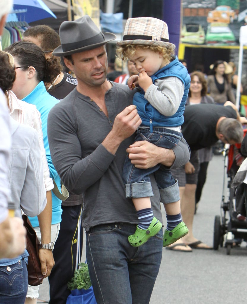 Justified star Walton Goggins carried his son Augustus during an Easter stroll through a farmers market in LA.
