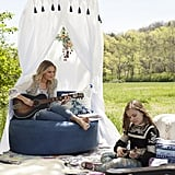 POPSUGAR Moms: Where did you each collect your inspiration for the collection from? Lennon and Maisy: For the most part, we both did a lot of Google imaging and searched different feelings that related to a bohemian style. We used Pinterest to create inspiration boards and then worked with the PBteen designers to create all the different patterns, colors, and styles we loved. Products pictured: Nashville Lounger ($999),  Indigo Printed Overdye Rug ($169-$699), Free Spirit Canopy ($199), Moroccan Vanity Stool ($259), Embroidered Peacock Pillow Cover ($45)