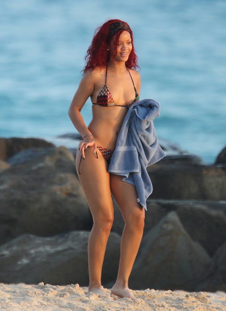 Rihanna headed home to Barbados for Christmas, but instead of holiday snowstorms she was greeted by tropical weather, which meant it was time to hit the beach. She sported a black one-piece with a panther on it for Sunday's sandy stroll, and yesterday she showed off more skin in her string bikini. She also tested out a jet ski, which is one of her favorite ocean activities. She's been hitting up the local scene and spending time with her family while in the Caribbean, but she'll be back to host a party at Pure in Las Vegas on New Year's Eve. Rih's love for Sin City has apparently been passed down to her siblings as she joked on Twitter that her 14-year-old brother was already asking to celebrate his birthday there next year.