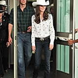 July 7th, 2011 Greeting onlookers at the Calgary Stampede in Calgary, Canada.   Kate wears an Alice by Temperly London Armonia blouse from the Resort 2012 collection. She paired the look with Goldsign Passion bootcut jeans and a cowboy hat gifted to her by the mayor of Calgary.