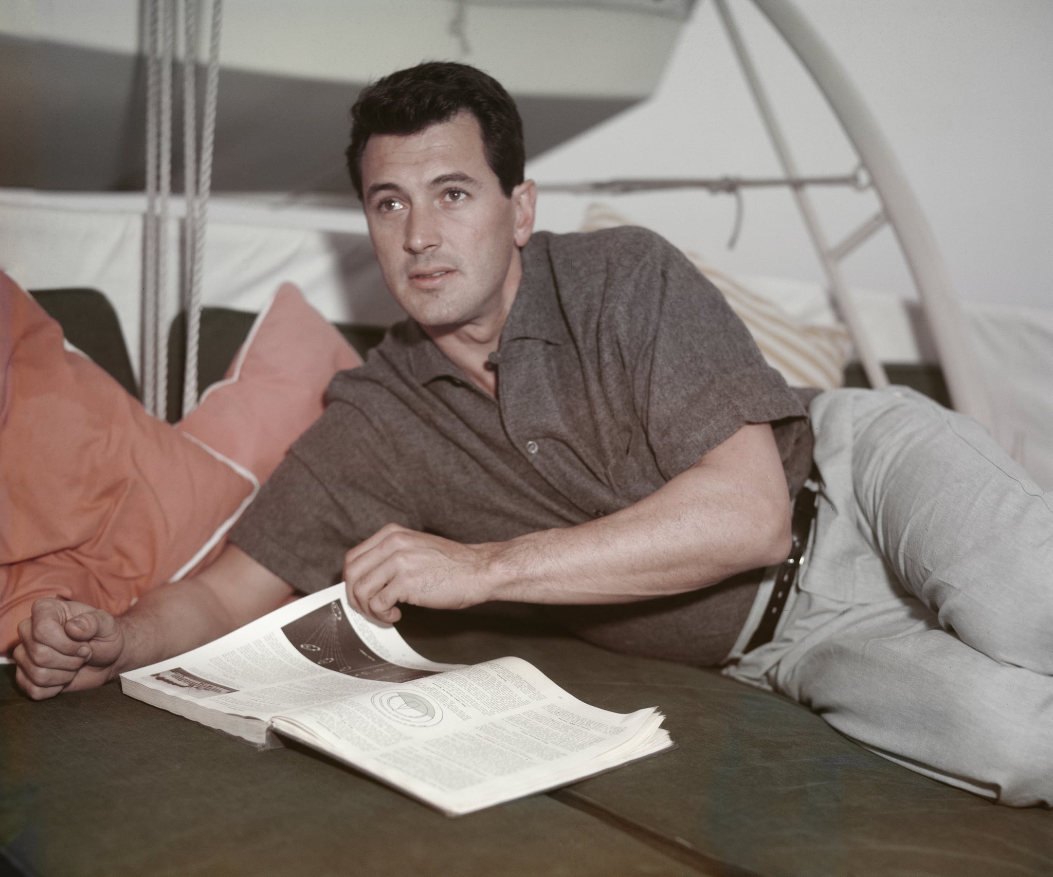 American actor Rock Hudson (1925 - 1985) reading a book, circa 1955.  (Photo by Archive Photos/Getty Images)