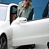 Miley Cyrus hopped into her white Mercedes.