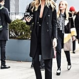 Martha Hunt rocking a very New York all-black, chic outfit during NYFW.