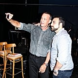 Tom Hanks took a snap with a friend in September 2013 at a Shakespeare festival at Santa Monica College. Source: Aleks Kocev/BFAnyc.com