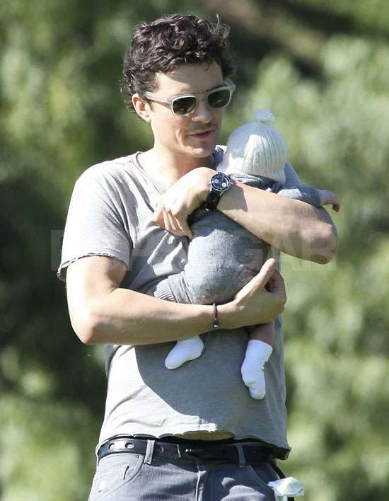 """Orlando Bloom snuggled his son Flynn close as they took a stroll in a state park in LA yesterday. The new dad couldn't stop smiling as he went out solo last week, following the birth of his first child with Miranda Kerr earlier this month. The couple shared a photo of Miranda breast-feeding Flynn, and she's posted another message today, saying: """"Our little man is now 17 days old and we are still pinching ourselves as to the reality of having had a baby and of having brought this beautiful little soul into the world and a beautiful little soul he is"""". Miranda also addressed the breast-feeding debate, saying she believes it """"is the most natural thing in the world and I love it"""". She added, however, that every woman had the right to choose, and recommended mothers make an informed choice for themselves. Miranda also pointed out: """"I for one can say there are more breasts being shown on a daily basis around the world in swimwear and low-cut dresses and tops than there are from breast-feeding mums""""."""