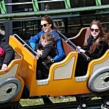 Honor snuggled up to mom Jessica Alba on an amusement park ride on Sunday.