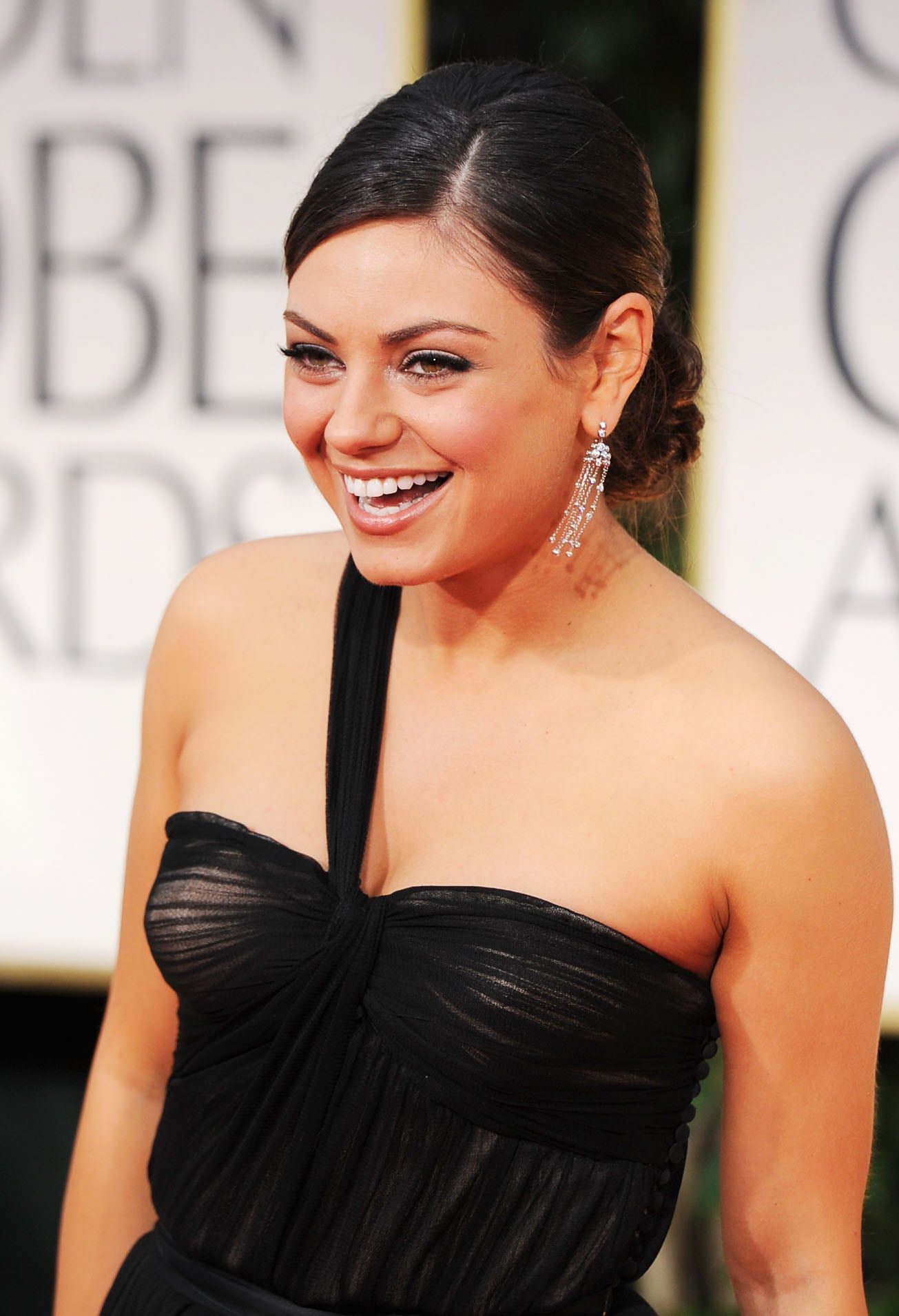 Mila Kunis in black at the Golden Globes.