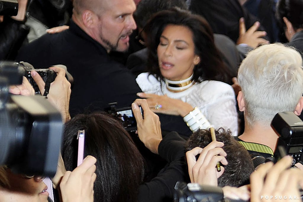 """Red carpet prankster Vitalii Sediuk shoved Kim Kardashian outside the Balmain fashion show during Paris Fashion Week on Thursday. You may remember Vitalii as the Ukrainian """"reporter"""" who punched Brad Pitt on the red carpet and attempted to get under America Ferrera's skirt at the Cannes Film Festival earlier this year. In Paris, he attempted to tackle Kim as she exited her limo alongside Kanye West and her mother, Kris Jenner. In footage from the scary encounter, Kim's bodyguards immediately tackle Vitalii, while Kris screams """"Stop it!"""" at the prankster. Kim, Kris, and Kanye didn't let the attempted assault get them down as they continued moving into the show while throngs of fans surrounded Vitalli and their car. Once inside the show, Kim smiled and posed for the cameras alongside her younger sister Kendall Jenner, who walked the runway.  After his attack on Brad, Vitalli was charged with assault and battery and sentenced to 20 days of community service and to undergo psychological counseling for one year."""