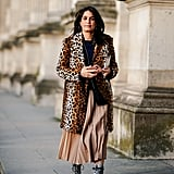 Style Your Leopard-Print Coat With: A Black Top, Tan Skirt, and Boots