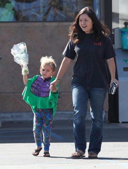 Kingston buying flowers with his nanny