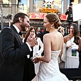 Jennifer Lawrence and Bradley Cooper on the red carpet at the Oscars 2013.