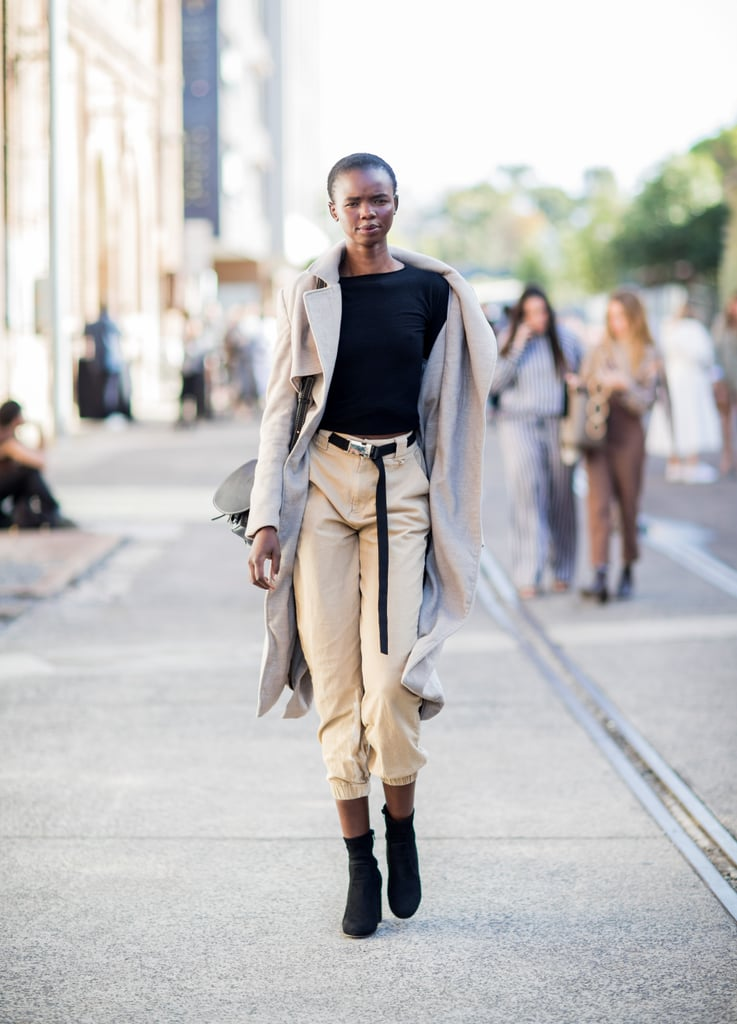 Pair a trench coat with cropped cargo pants for an effortlessly chic look.