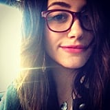 The perfect pairing for glasses? Emmy Rossum's hot pink lipstick, of course. Source: Instagram user emmyrossum