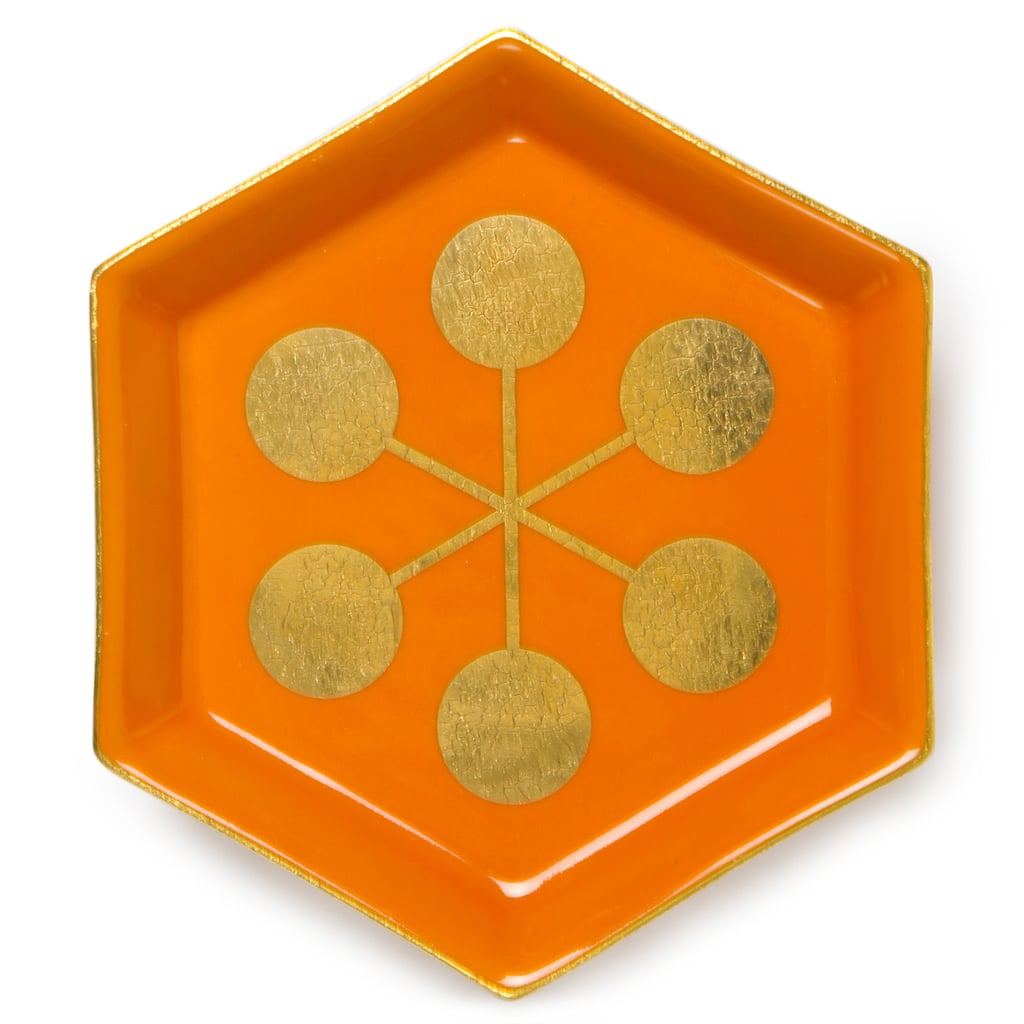The Jonathan Adler Orange Asterisk Stacking Dish ($38) would easily dress up a vanity or desk space with a bright, punchy pop of color and real gold accents.