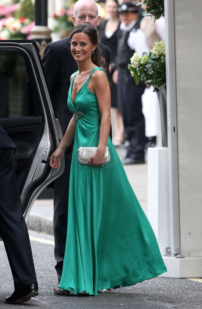 """>> Some are convinced that maid of honor Pippa Middleton upstaged her sister on her wedding day, and the emerald green dress she chose to wear to the evening reception festivities at Buckingham Palace isn't discouraging that school of thought. While Kate Middleton changed into another demure dress by Sarah Burton for Alexander McQueen, Pippa swapped her McQueen dress from this morning for a sleeveless gown with a plunging neckline designed by Alice Temperley. Temperley, for her part, was happy to hear that she was Pippa's choice:""""It was a wonderful opportunity and an honor to work with Ms. Pippa Middleton. She is a beautiful young woman, with such elegance and looked stunning at the reception."""""""