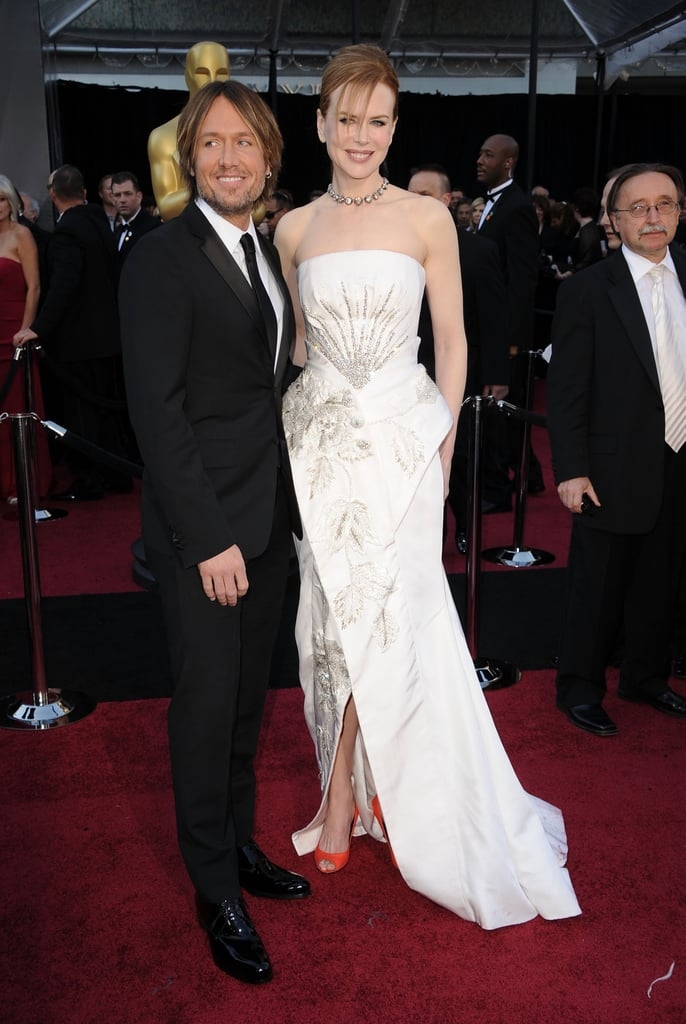 Nicole Kidman picked Dior for the red carpet at the Oscars in LA. The dress many not go down in history as one of Nicole's most universally loved selections, but she looked so happy posing with her husband Keith Urban. The Academy Awards marks the end of a long award season for Nicole, who's been honored for her acting in Rabbit Hole.