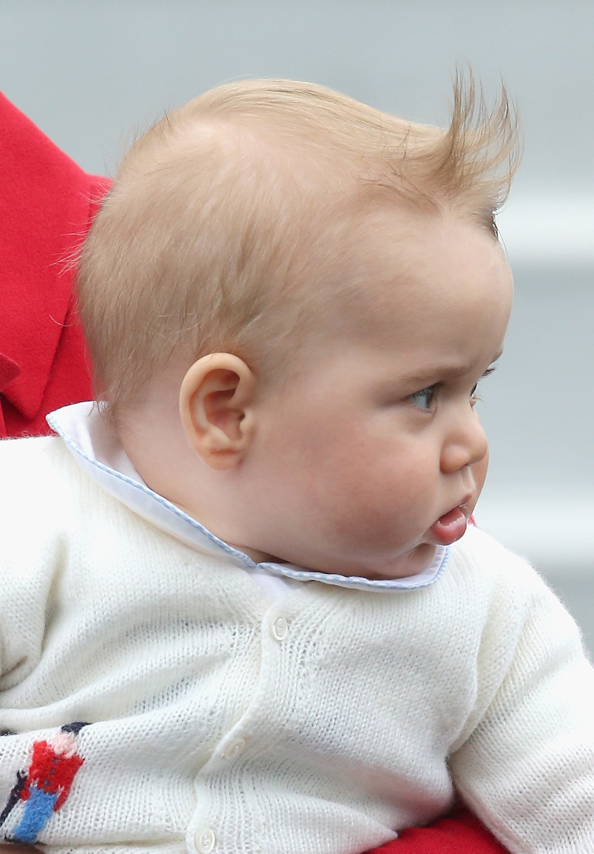 We're pretty sure the queen would not approve of this wind-induced fauxhawk.