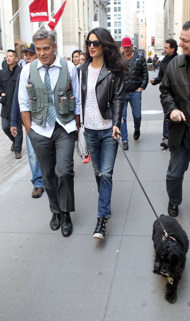 Wearing distressed denim with a leather Balenciaga moto jacket, completing the look with Ash wedge sneakers.