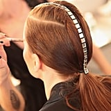 A daring hair accessory at BlacMera.