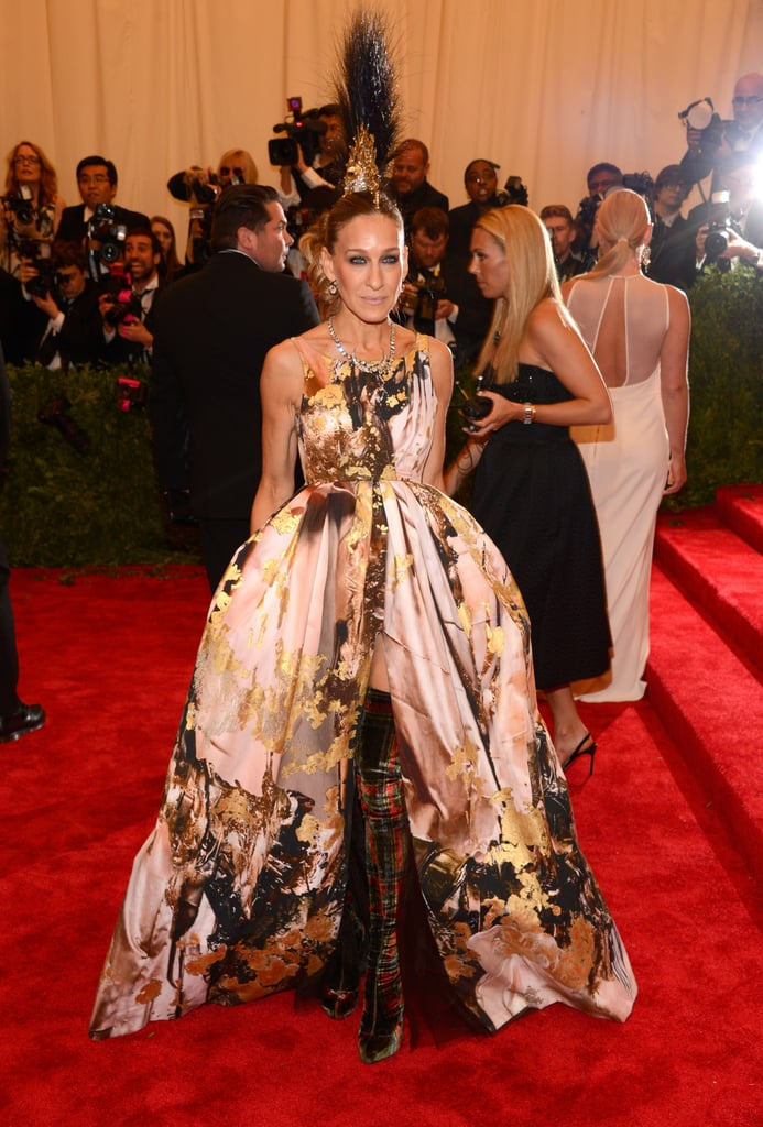 Sarah Jessica Parker made an unforgettable entrance at last year's Met Gala, embracing the Punk Chaos theme in a voluminous, gold-leaf Giles creation, Christian Louboutin tartan thigh-high boots, and a showstopping mohawk headpiece by Philip Treacy.