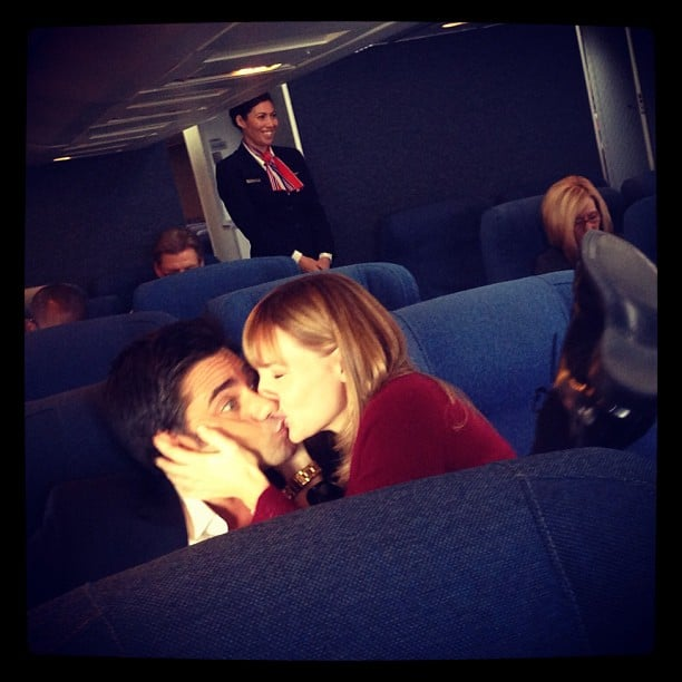 John Stamos got a serious smooch while filming a commercial for Dannon. Source: Instagram user johnstamos