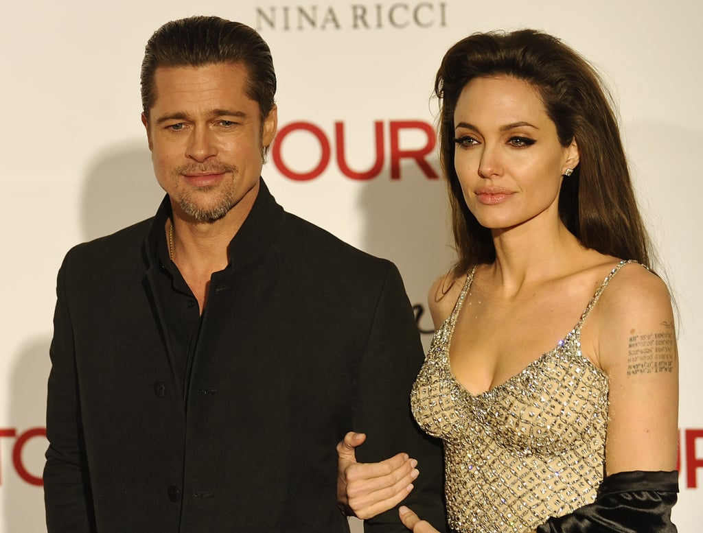 Angelina Jolie had Brad Pitt on her arm as she joined Johnny Depp at tonight's Madrid debut of The Tourist. She and Johnny were together again after kicking off the day with a photo call. The onscreen pair were both surprisingly nominated for Golden Globes due to their work in the movie, though they didn't receive any nods at this morning's Screen Actors Guild Awards announcement.  The beaded top Angelina chose today is just one of several dramatic looks she's worn during the European press tour, while Johnny has chosen to stick to his signature casual style.