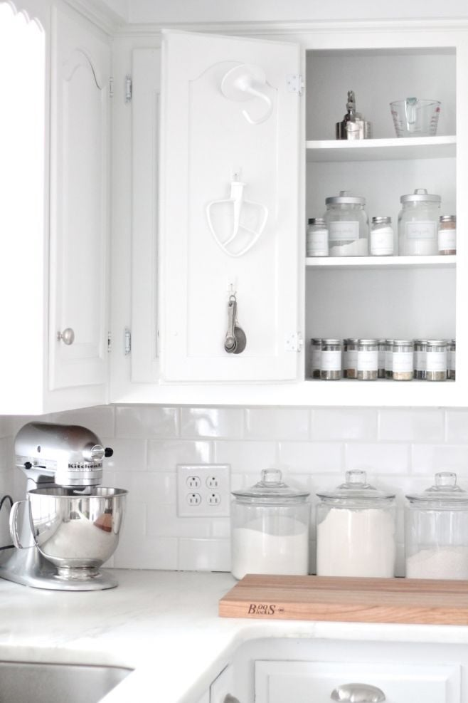 Free up drawer space by hanging some of your most-used baking tools from the back of your cabinet, keeping them close to other baking essentials like sugar, flour, and spices.