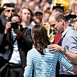 Will and Kate kept their hands around each other while posing for photos during a tour of Germany in July 2017.