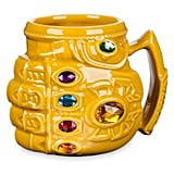 A bejeweled mug like this Thanos Infinity Gauntlet Mug ($20) is just fancy enough.