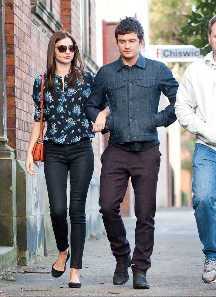 Miranda Kerr wore a floral shirt and Orlando Bloom a denim jacket while out and about in Sydney together.