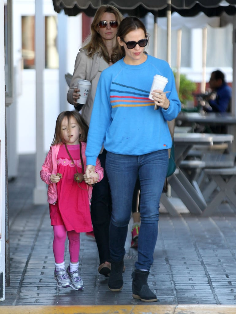 """Jennifer Garner held hands with her daughter Seraphina after they picked up breakfast at the Brentwood Country Mart in LA this morning. The girls had some mother-daughter time while Sera's older sister, Violet, was off at school and her little brother, Samuel, was elsewhere. One thing that brings the Garner kids together with their parents, though, is reading. Jennifer recently opened up to People magazine about what her little ones like to read. She said, """"We love A Series Of Unfortunate Events by Lemony Snicket. My daughter Violet is so into the series, she talks about the Baudelaire kids like they are part of our family. It's a blast."""""""