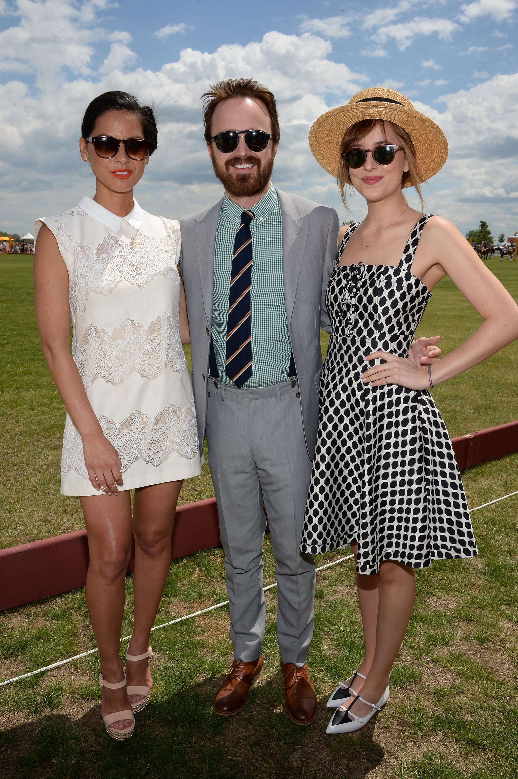 The blue and cloudy sky was the backdrop of Olivia, Aaron, and Dakota's day at the polo event.
