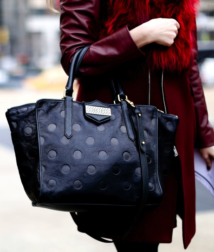 This black polka-dot satchel was the perfect contrast against this maroon coat.