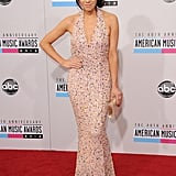 Carly Rae Jepsen shimmered in a pink sequined Gomez-Gracia gown and paired the look with an Edie Parker clutch.