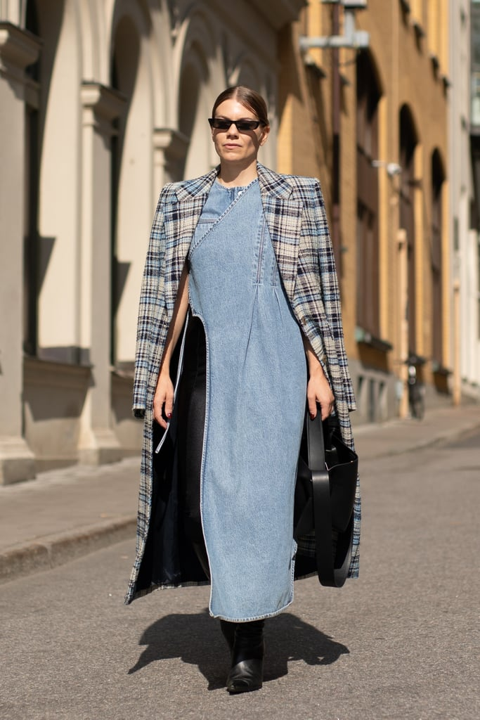 Top denim with a plaid coat for a Fall-feeling transitional style.