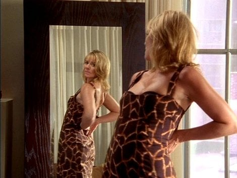 Proving even a giraffe-inspired print is sexy, Samantha poses in a corseted Dolce & Gabbana dress.