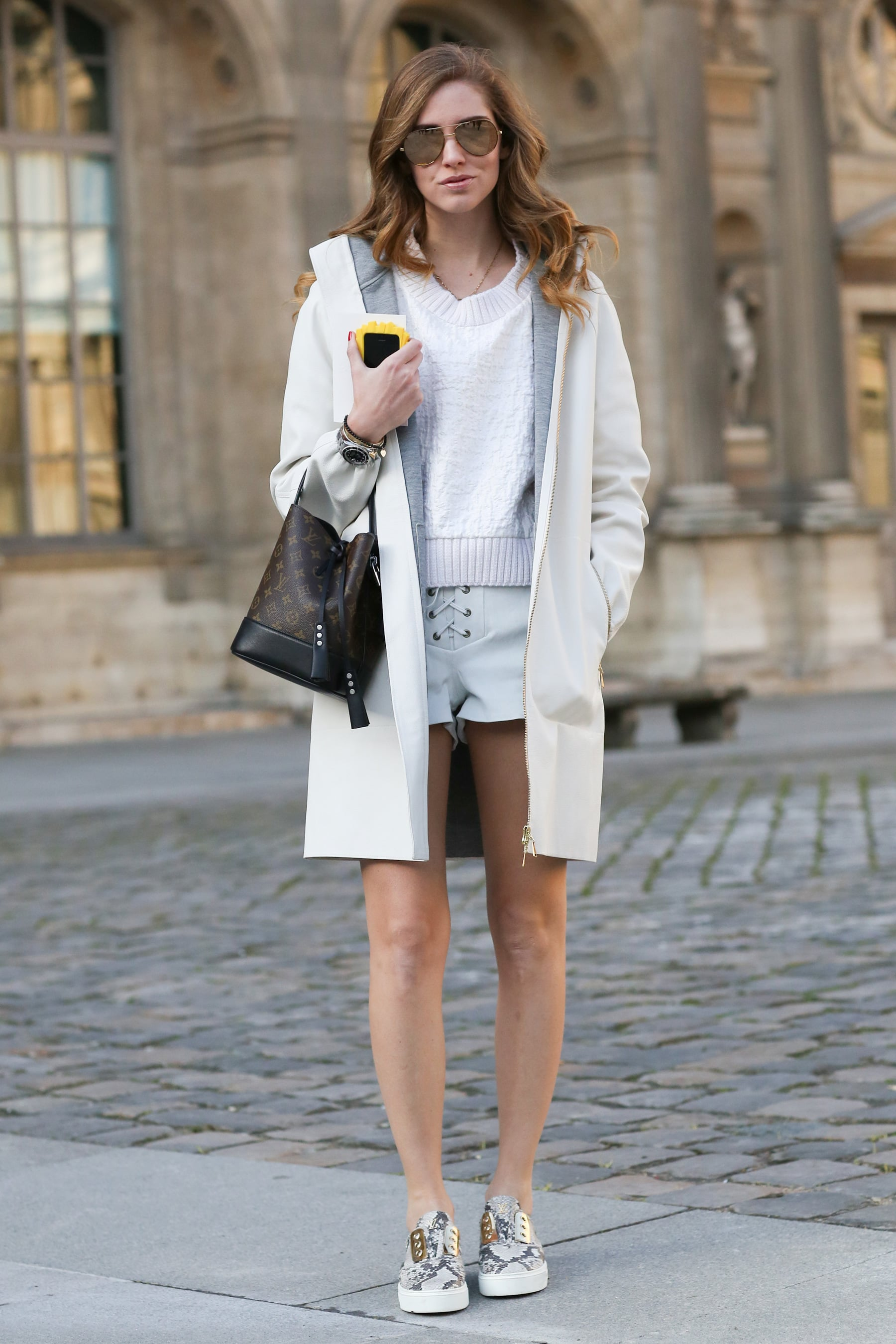 Chiara Ferragni's slip-ons lend just the right sporty vibe to finish off her shorts and sweater combo.