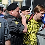 Russian riot policemen detained a supporter of the all-girl punk band.