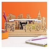Keep everything neat and in place thanks to this laser-cut wood  skyline desk organizer ($25) that comes with a pen holder and three slots for mail and messages.