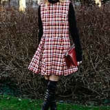 Olivia rocked a plaid fit-and-flare for the Dior show in 2016.