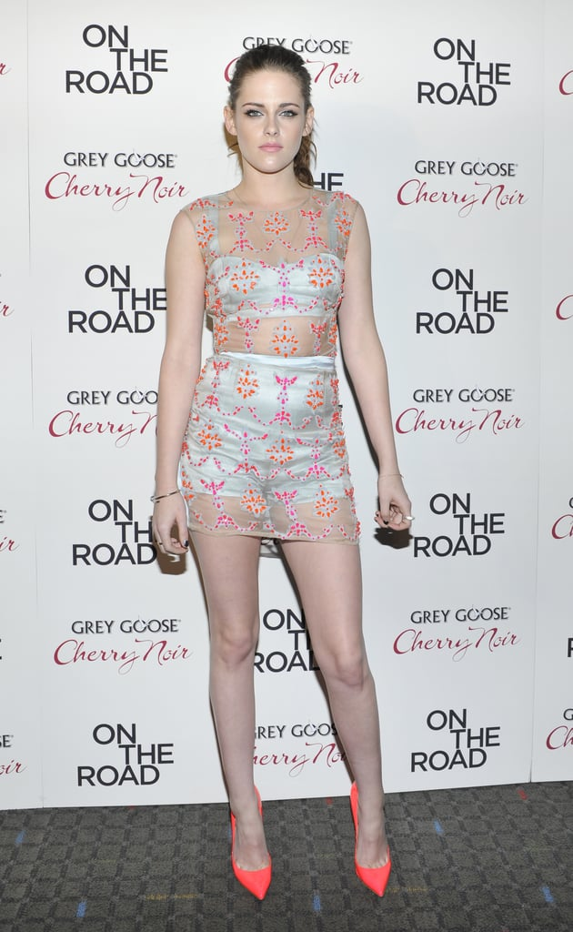 Kristen continued her reign as a skin-baring red-carpet star in December, wearing a blue satin crop top and high-waisted short Erdem combo with neon Christian Louboutin pumps.
