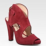 Add a pop of color via red cutout heels. Rebecca Minkoff Demure Suede Peep Toe Ankle Boots ($118, originally $295)