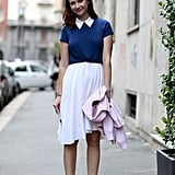 Glamour's Christina Perez paired a white skirt with a preppy top.
