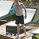 Damian Lewis held a ball near his hotel's pool.
