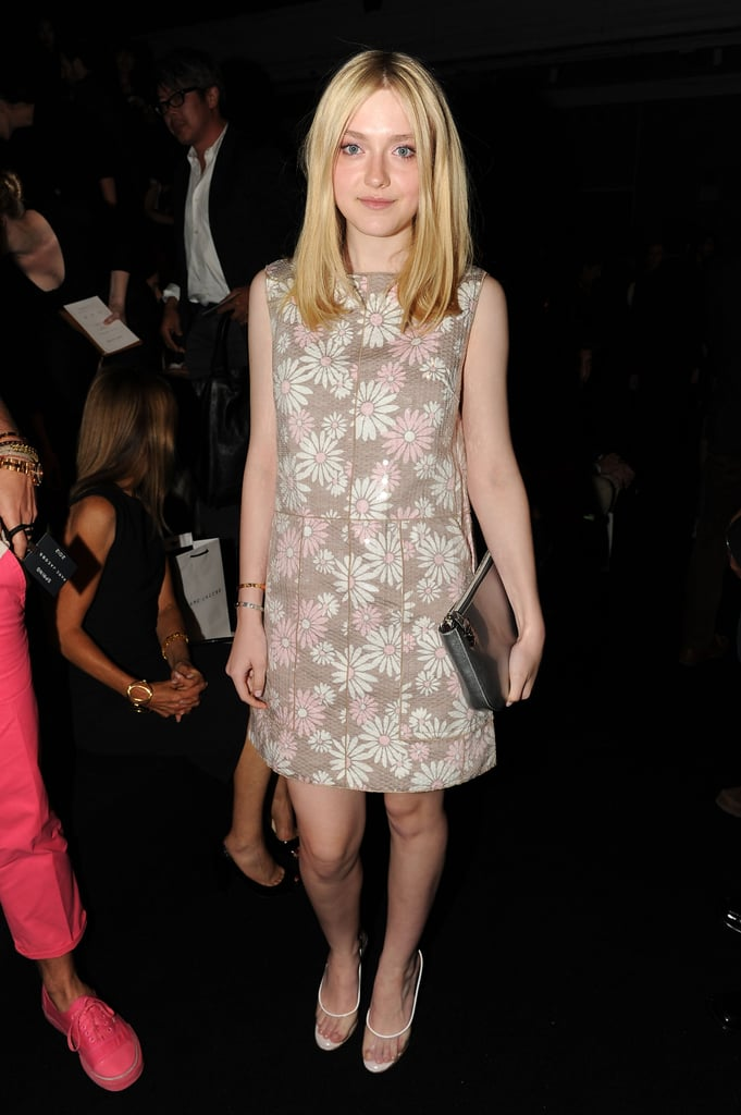 Dakota wore a floral shift to the presentation.