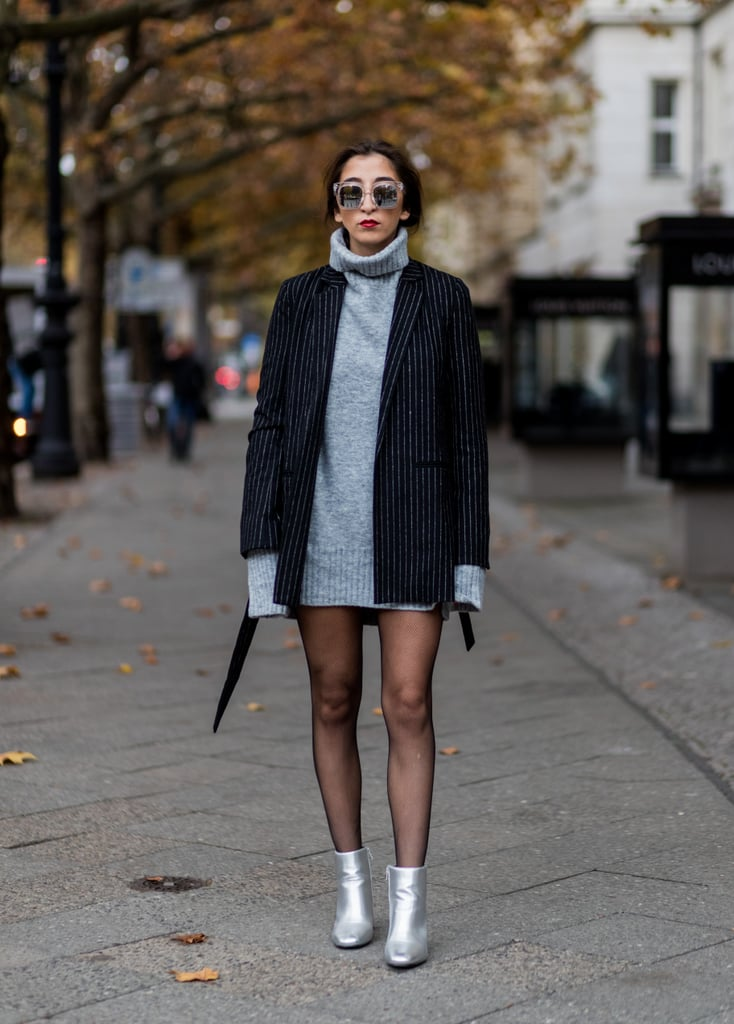 With A Grey Sweater Dress A Striped Coat And Silver Ankle Boots