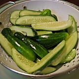 First, the pickling cucumbers (I chose Kirby) get salted and drain for an hour.