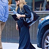 Ashley Olsen in Black Flip-Flops and Maxi Dress July 2018